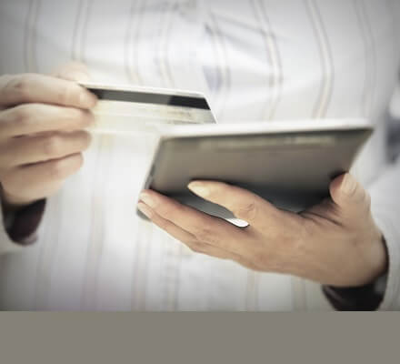 Woman with credit card and digital tablet